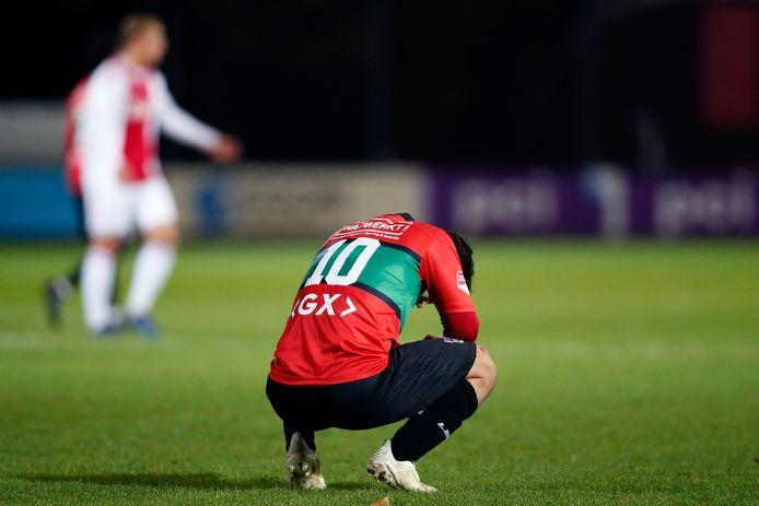 Teleurstelling bij NEC-speler Anass Achahbar na de afgang bij Jong Ajax.