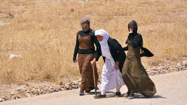 Yezidi's, een van de oudste geloofsgemeenschappen van het Midden Oosten, op de vlucht voor ISIS. Beeld REUTERS