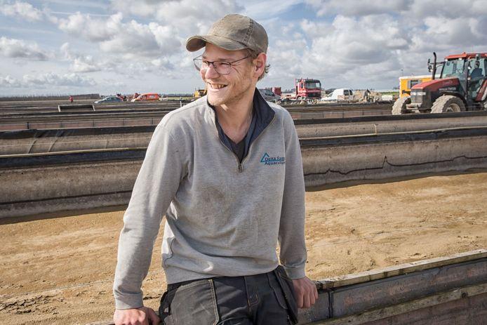 De 25-jarige Jaap Meijering bij de kweekvijvers van zijn bedrijf Delta Farms.