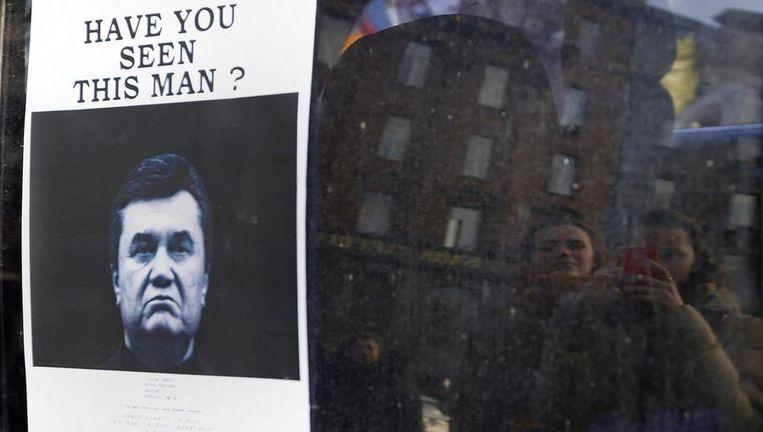 Een poster van de verdreven Oekraïense president Viktor Janoekovitsj. Beeld reuters