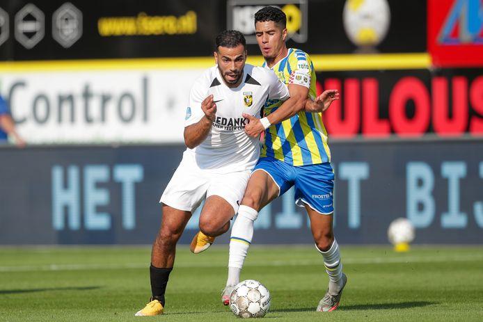Oussama Tannane  in duel met Anas Tahiri van RKC Waalwijk.