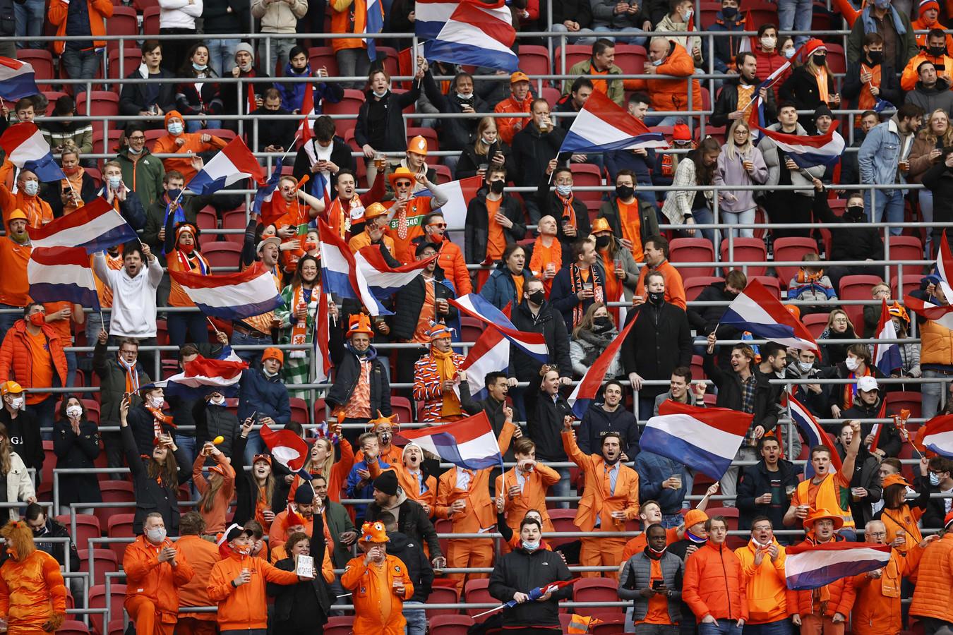 Supporters tijdens de WK-kwalificatie wedstrijd tussen Nederland en letland in de Johan Cruijff Arena op 27 maart in Amsterdam.