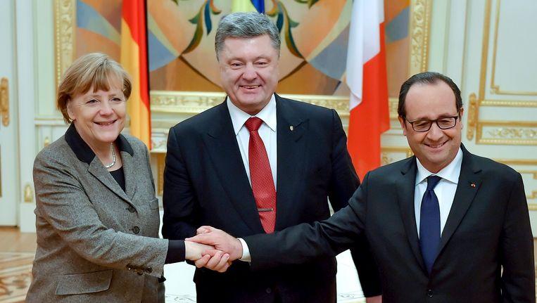 De Duitse bondskanselier Merkel, de Oekraïense president Porosjenko en de Franse president Hollande. Beeld EPA