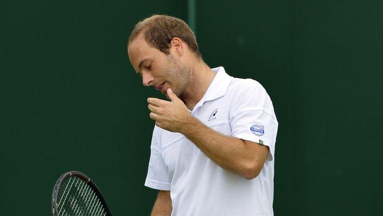 Ook voor Olivier Rochus zit Wimbledon er al op. Beeld BELGA