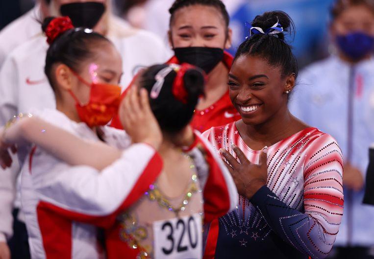 Biles en de Chinese winnaars. Beeld REUTERS