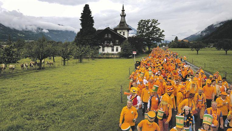 Oranje-fans in Interlaken tijdens het EK 2008. Het Oranje-legioen werd mede door de inzet van SCO wereldberoemd. Beeld Gerald van Daalen