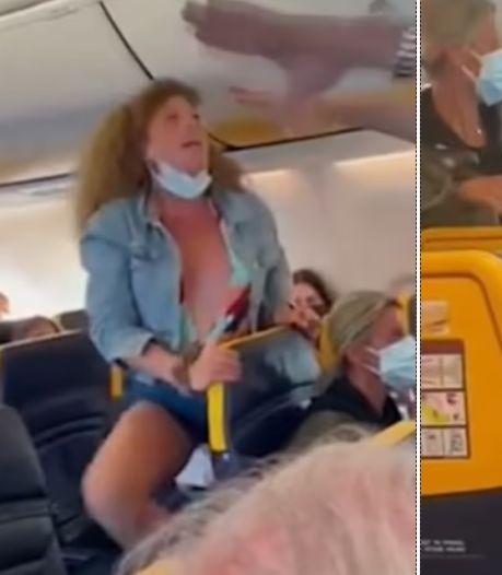 Vrouw spuwt, trapt en trekt aan haar van passagier om mondkapjesdiscussie
