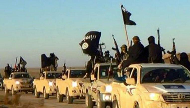 IS-strijders bij de inname van de Syrische stad Raqqa, in juni 2014. Beeld AP