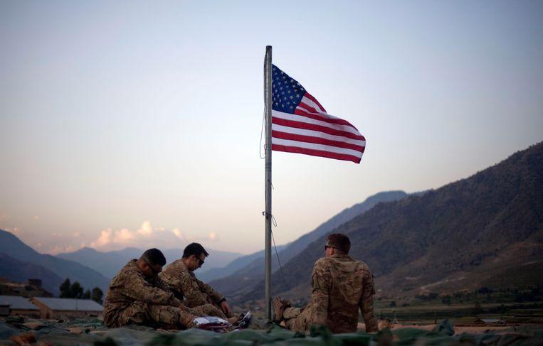 September, 2011. Amerikaanse soldaten in Afghanistan herdenken de aanslag van 9/11, tien jaar eerder.  Beeld AP