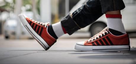Waarom je succesvoller lijkt met rode sneakers aan