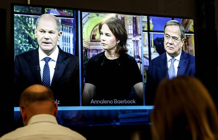 Olaf Scholz, Annalena Baerbock en Armin Laschet tijdens het debat. Beeld EPA