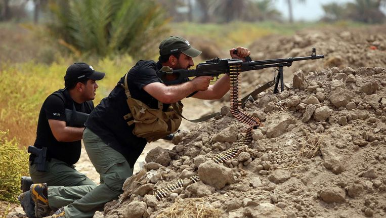 Sjiitische Irakezen vechten aan het front tegen de jihadisten van de Islamitische Staat. Irak wordt geteisterd door de opmars van IS, maar ook door (zelfmoord)aanslagen van andere groeperingen. Beeld afp