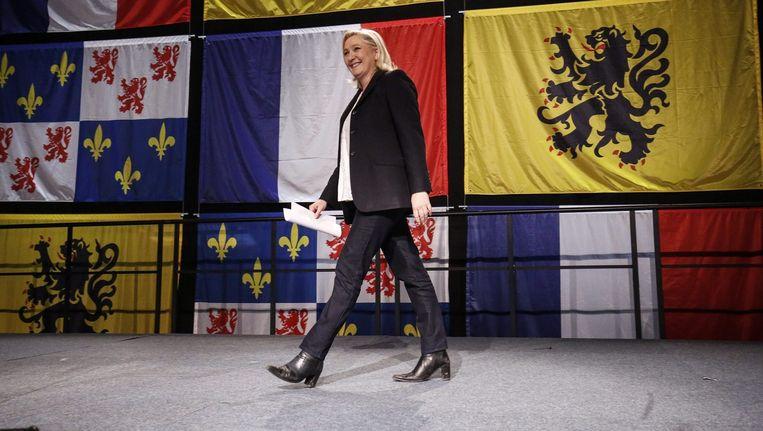De overwinningsspeech van Le Pen in Hénin- Beaumont. Ze trekt steeds meer hoogopgeleide kiezers aan. Beeld © epa
