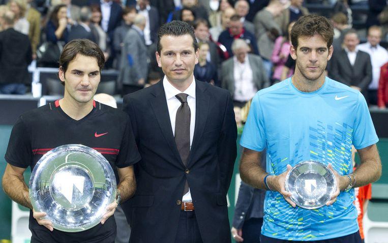 De finalisten van 2012, Roger Federer (links) en Juan-Martin del Potro, tussen toernooidirecteur Ricjard Krajicek in. Beeld anp