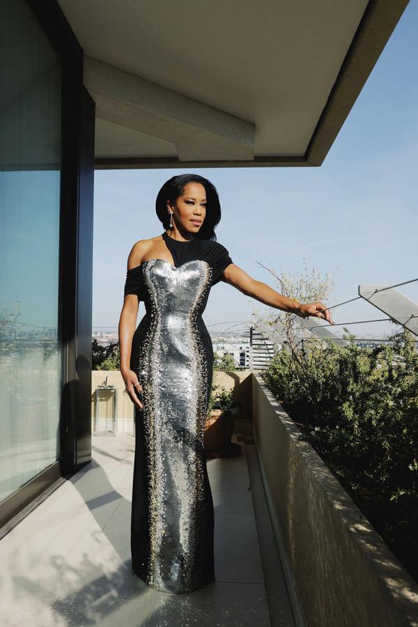 L'actrice, réalisatrice et productrice américaine Regina King habillée d'une robe Louis Vuitton.