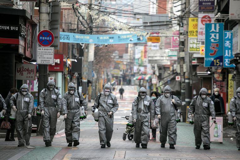 Virusbestrijding in Zuid-Korea. Beeld Getty
