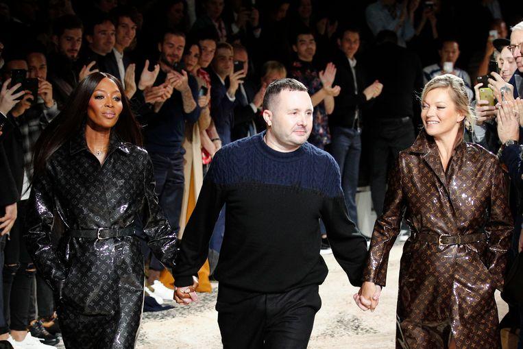 Kim Jones met Kate Moss en Naomi Campbell. Beeld AP