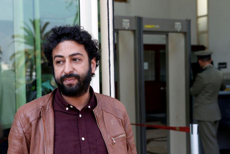 Journalist Omar Radi maart vorig jaar, buiten aan de rechtbank van Casablanca.  Beeld REUTERS