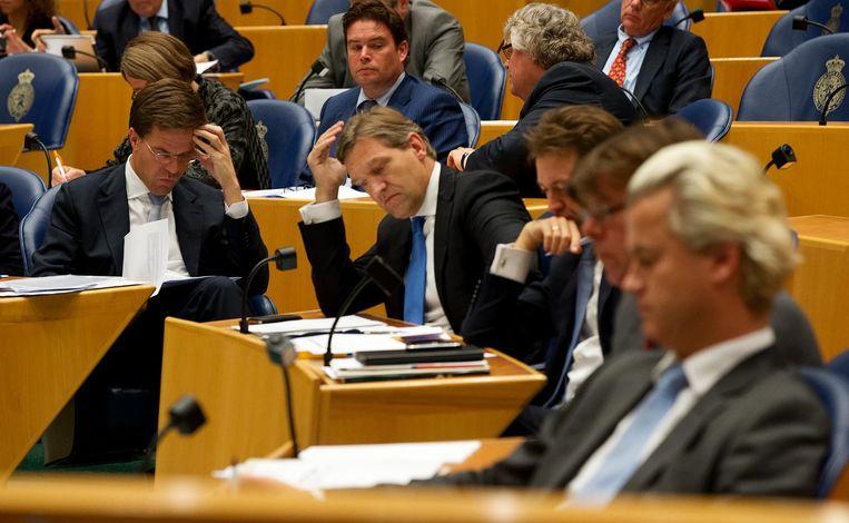Partijleiders Mark Rutte (VVD), Sybrand Buma (CDA) en Geert Wilders (PVV) Beeld null