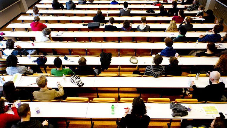 Studenten van de Universiteit van Amsterdam in de collegebanken. Beeld anp