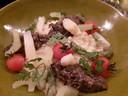Fregolapasta met paddenstoelen duxelles en gepofte cherrytomaatjes.
