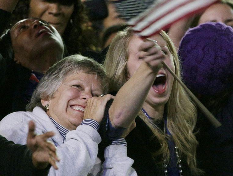 Aanhangers van Barack Obama bejubelen zijn overwinning in Chicago. Beeld reuters