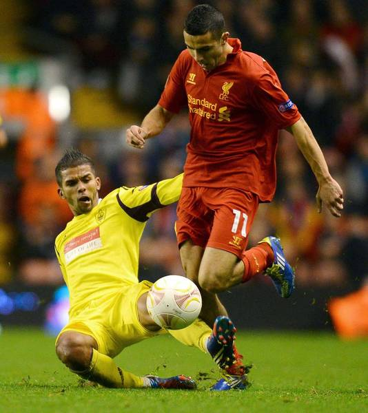 Oussama Assaidi namens Liverpool in actie tegen Anzhi.