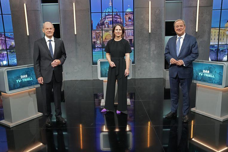 Olaf Scholz, Annalena Baerbock en Armin Laschet tijdens het debat. Beeld Kay Nietfeld/dpa