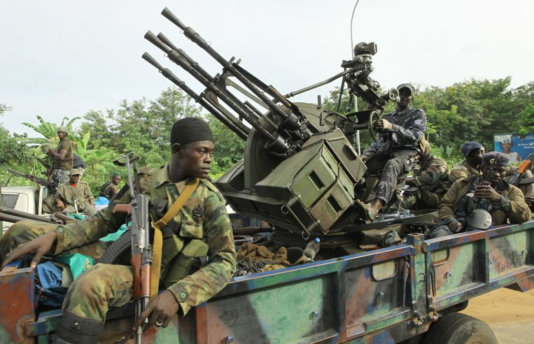 Internationally recognised leader Alassane Ouattara's FRCI (Republican Forces of Côte d'Ivoire) soldiers ride an armed vehicle in front of the Golf hotel in Abidjan, on April 5, 2011. The army chief of staff loyal to Ivory Coast strongman Laurent Gbagbo told AFP today that his troops had stopped fighting against rival Alassane Ouattara's forces. Ouattara's forces launched what they called a