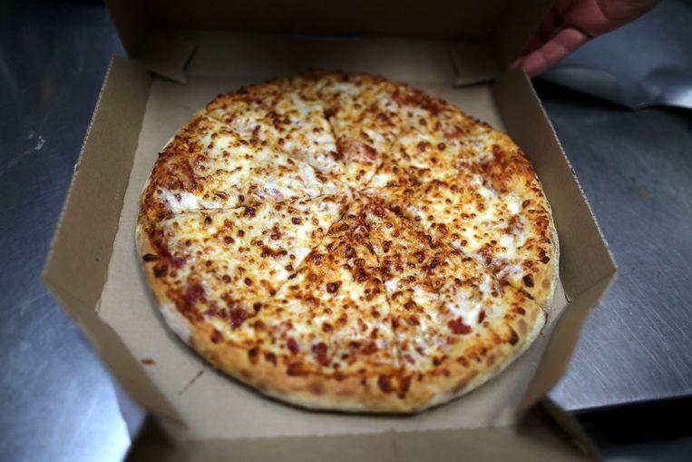 Zelfs Domino's Pizza in Londen hamstert voor de Brexit: tomaten voor de tomatensaus. Beeld REUTERS