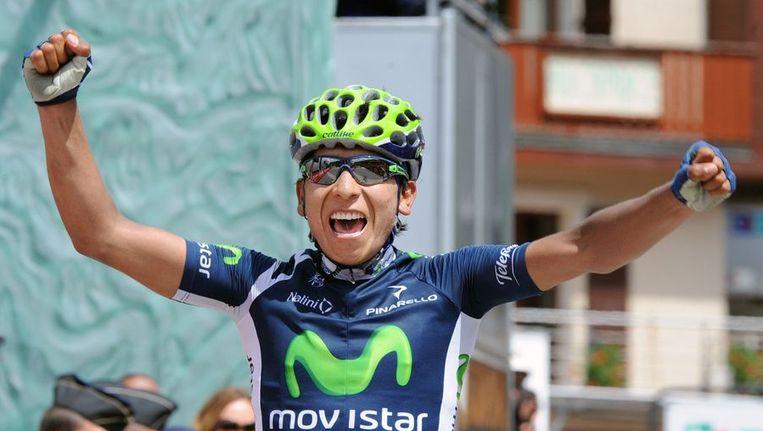 De Colombiaanse renner Nario Quintana komt als eerste over de meet. Beeld afp