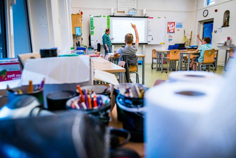 Met halve klassen gaan de meeste basisscholen vanaf 11 mei weer aan de slag.  Beeld ANP