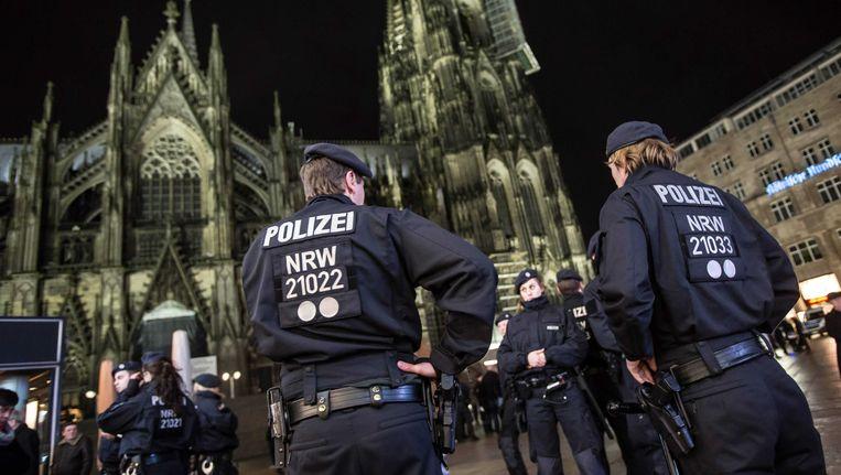 Politie bij de Dom in Keulen. Beeld EPA