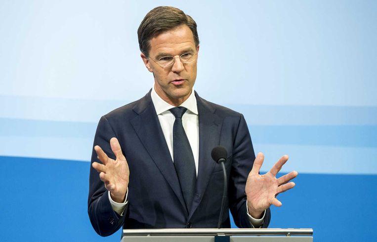 Premier Rutte tijdens zijn wekelijkse persconferentie vrijdag. Beeld anp