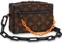 Een tas uit de Louis Vuitton-collectie van ontwerper Virgil Abloh (1900 euro) waar je de hiphopinvloeden terugziet in de ketting.