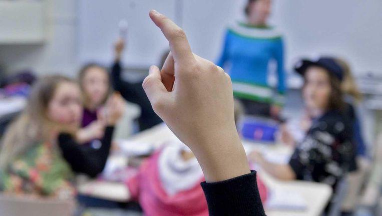 Moderne wetenschappelijke bevindingen kunnen de docent helpen bij het werk in de klas. Beeld Koen Suyk/ANP XTRA
