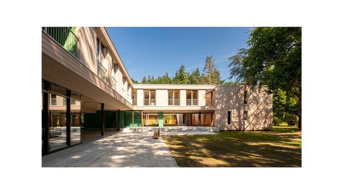 De houten appartementen die woningcorporatie Trudo liet bouwen op landgoed Eikenburg in Eindhoven. Ontwerp: FAAM Architects
