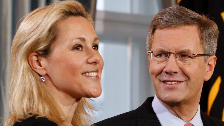 Christian Wulff en zijn echtgenote Bettina in januari 2012. Een jaar later maakte Wulff bekend dat ze zouden scheiden. Beeld REUTERS