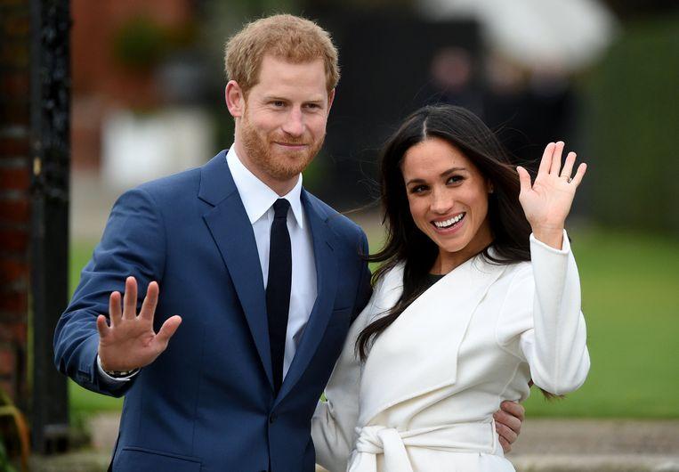 De Britse prins Harry met  zijn verloofde Meghan Markle in London. Beeld EPA