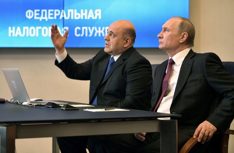 Een beeld waar u aan zal moeten wennen: nieuwbakken premier Michail Misjoestin naast zijn echte patron Vladimir Poetin. Beeld VIA REUTERS