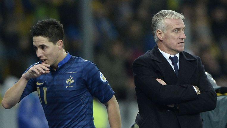 Samir Nasri (L) en de Franse bondscoach Didier Deschamps (R) Beeld afp