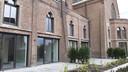 Het oude kerkgebouw aan de Boschweg in Schijndel is verbouwd tot 33 wooneenheden voor mensen met een beperking.