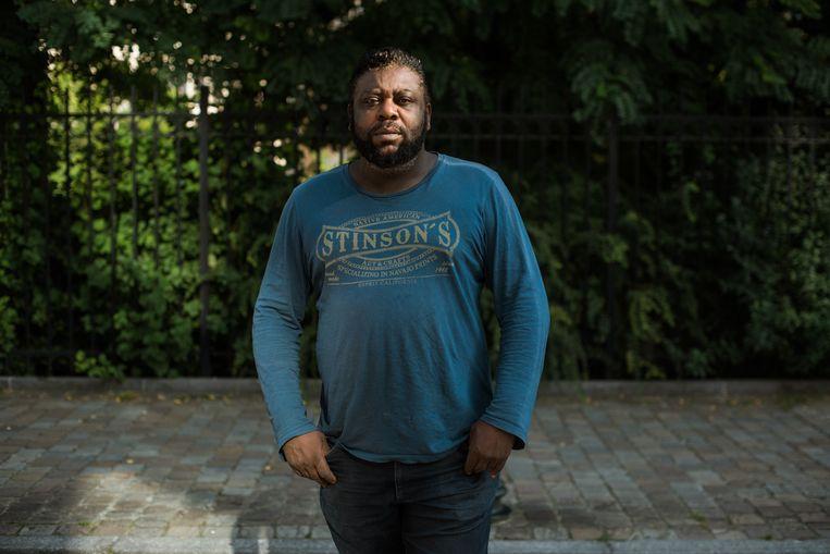 David Kabamba Kabangu. 'Aanvankelijk vielen mijn klachten mee, maar na enkele dagen voelde ik alle kracht uit mijn lichaam wegvloeien.' Beeld Wouter Maeckelberghe
