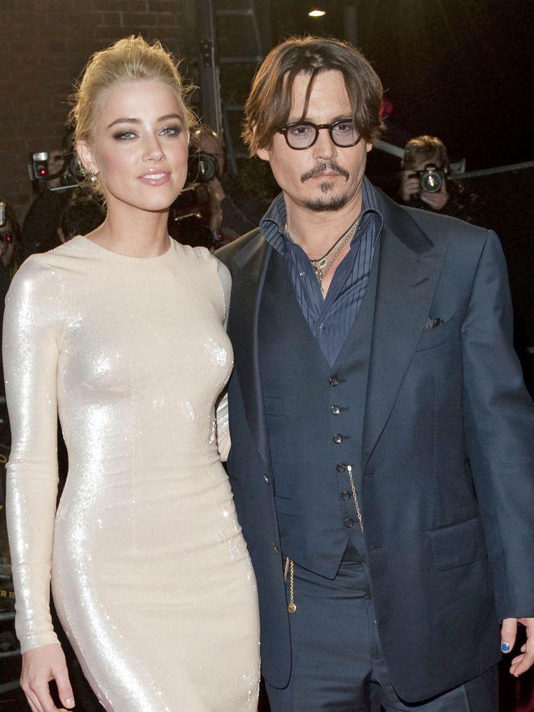 Amber Heard en Johnny Depp ontmoetten elkaar op de set van 'The Rum Diary'. Beeld UNKNOWN