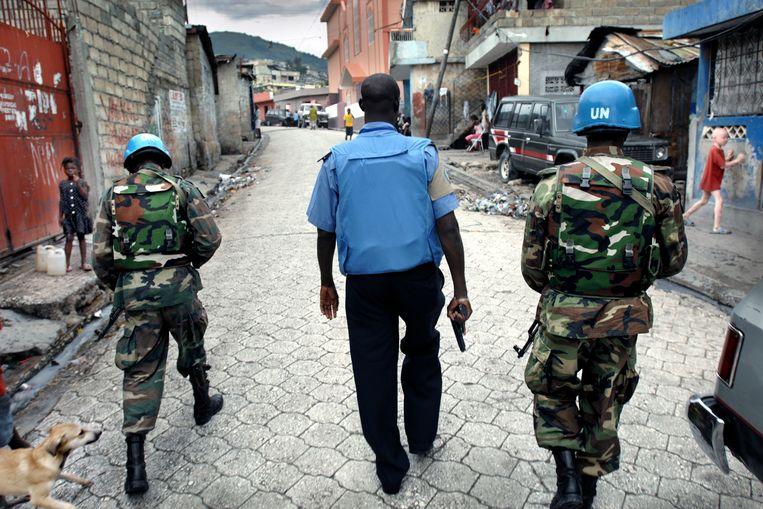 Buitenlandse VN-militairen in 2009. Ze bewaakten de orde tussen 2004 en 2017. Beeld Joost van den Broek