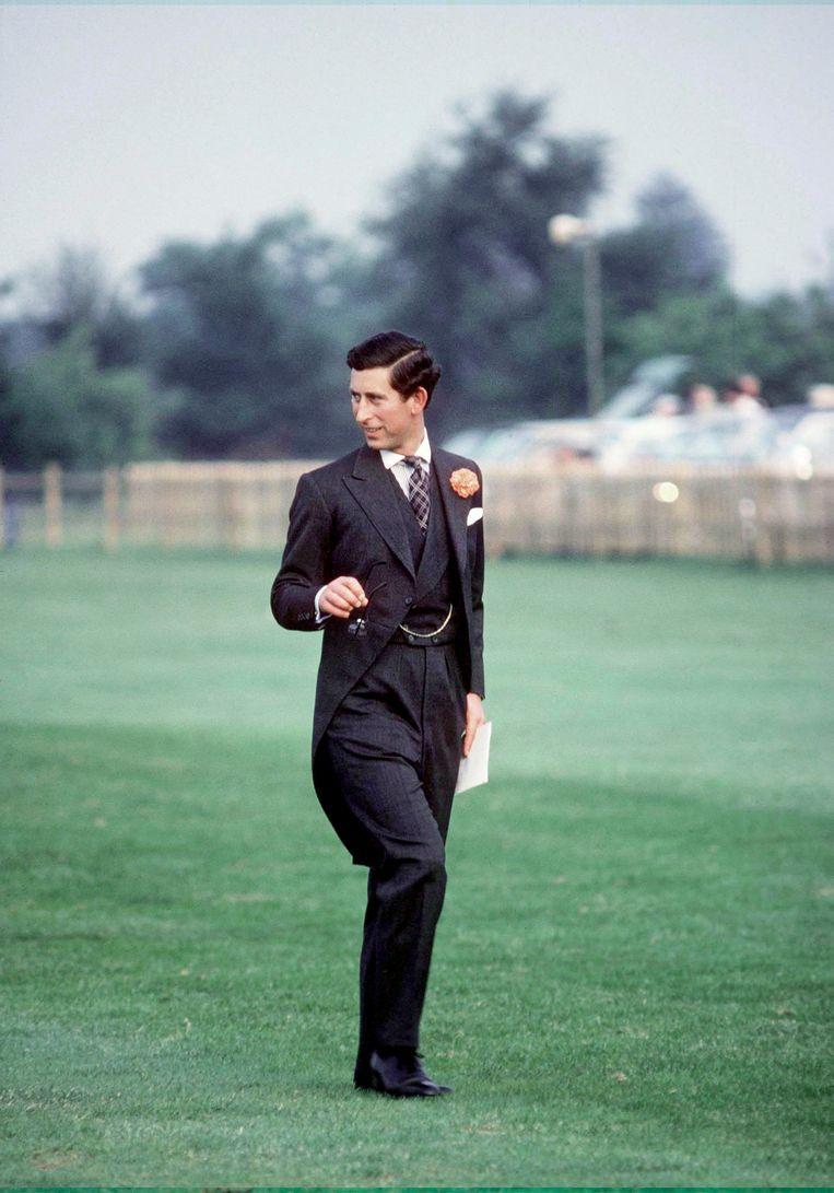 Ascot, 1975. Dresscode: morning dress, wat onder meer inhoudt een pandjesjas, waarvan de achterkant tot de knieholte reikt.   Beeld Getty Images